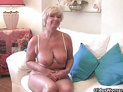 Granny with big tits masturbates with her sex toy collection tubes