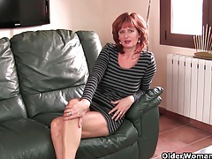 Mature redheaded mom masturbates on the couch tubes