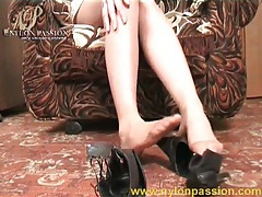 Sheer pantyhose on beautiful feet in close up tubes