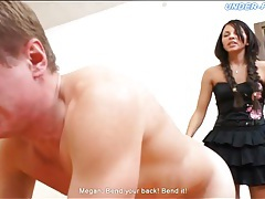 Mistress in braided pigtails flogs his back tubes