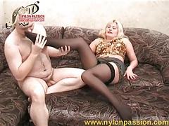 Blonde babe in black stockings sucks cock tubes