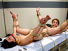 Two sluts tied to the bed tubes