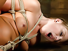 Girl suffers in bondage tubes