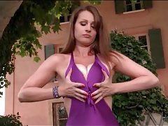 Purple swimsuit looks gorgoeus on babe outside tubes