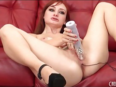 Redhead pleasures pussy and ass with toys tubes