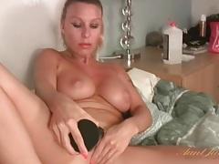 Black dildo fucks milf chick with big tits tubes