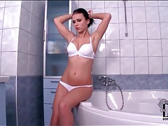 Sexy brunette strips and takes a bath tubes