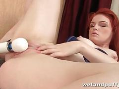 Redhead masturbates with her vibrator tubes