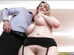 Curvy blonde in sexy black stockings sucks dick tubes