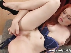 Redhead stuffs panties in her sexy pussy tubes