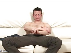 Athletic young man masturbates his shaft tubes