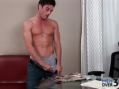 Hottie strokes his dick to porn in the office tubes