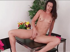 Sexy brunette with fit body masturbates tubes