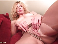 Solo blonde mom masturbates in sheer pantyhose tubes