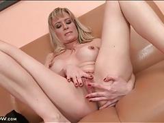 Round fake titties on masturbating blonde milf tubes