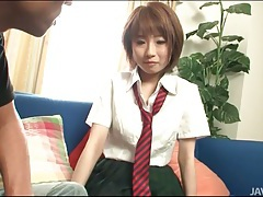 Japanese cutie in short skirt fools around tubes
