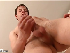 Hot load of jizz lands on his stomach tubes