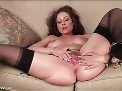 Hottie in high heels and nylons masturbates tubes