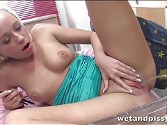 Young blonde plays with her hot urine tubes