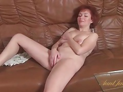 Mature redhead masturbates solo on leather couch tubes