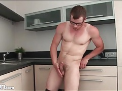 Fit guy in glasses strips and jerks off tubes