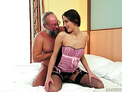 Grandpa eats out a young lady in lovely lingerie tubes