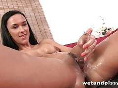 Pissing brunette makes a sticky mess with it tubes