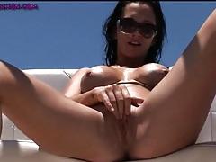 Bikini babe masturbates her cunt on a boat tubes
