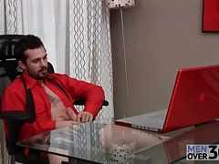 Bearded guy jerks off big cock in office tubes