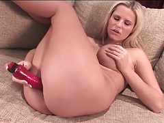 Blonde fucks her long pink dildo so deep tubes