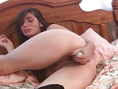 Dildo up her milf pussy and against her clit tubes