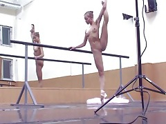 Teen ballerina works out on the bar tubes