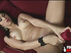 Babe on back fucks big dildo lustily tubes