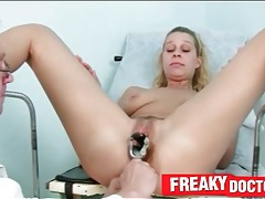 Metal speculum opens pussy of a blonde girl tubes