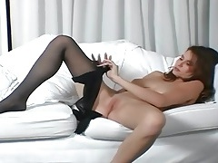 Brunette with big tits rubbing her pussy in nylon tubes