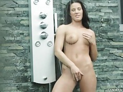 Tight body gets wet in outdoor shower tubes