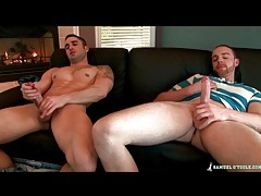 Guys sit on the couch and jerk off together tubes