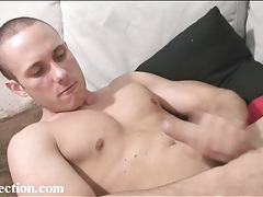 Naked guy with nice pecs strokes his hard dick tubes