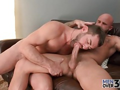 Two hairy hot guys in a gay blowjob 69 tubes