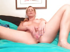 Blonde with big breasts finger fucks her cunt tubes