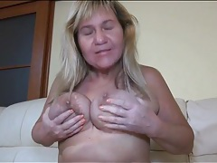 Curvy mature sucks her tits and toys her pussy tubes