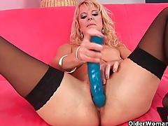 Over 50 mom probes herself with a big dildo tubes