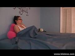 Cutie in glasses masturbates under the sheets tubes