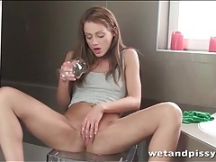 Sophie lynx plays with a glass full of piss tubes