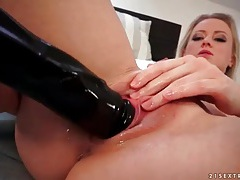Dildo fucking and fisting chick with implants tubes