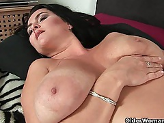 Sultry mature mom with big tits fucks herself with two dildos tubes