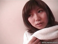 Asian in soft white sweater flashes tits in public tubes