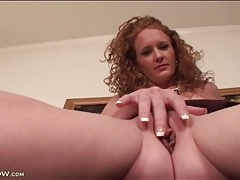 Sexy milf redhead masturbates pussy in close up tubes