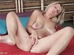 Blonde milf with saggy tits fingers her bald cunt tubes