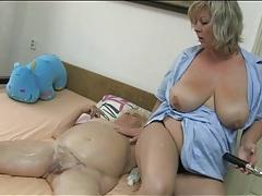 Nurse rubs lotion into her fat granny body tubes
